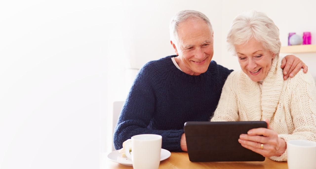 Ehepaar mit einem Tablet